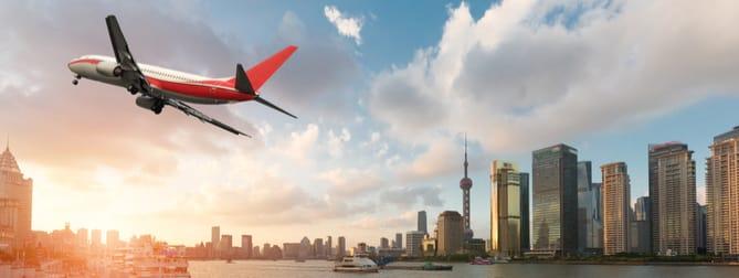 Commercial airline flying over Shanghai