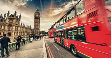 London Slow Motion Picture of Bus Driving By Street With Big Ben Clock In Background