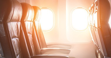 Airplane Seats Against Sunset